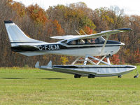 C-FJEM @ CNV6 - This Stationair looked good in black paint as it taxied to the active. The Co-pilot in the right seat was a young kid. He must have been very excited to go flying! This Cessna lives here at Orillia's Lake St. John seaplane base. - by Chris Coates