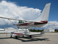 C-GANE @ CYEM - This Cessna was resting in the middle of the ramp as a wall of cumulus clouds approached from the north. Soon it had a cold bath! Today it lives far away at Fort Simpson in the Northwest Territories. - by Chris Coates