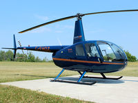 C-FHOZ @ CLA4 - This 2006 Robinson R44 II sits outside the Silverline Helicopters hanger at Holland Landing Airport (CLA4) north of Toronto - by Ron Coates
