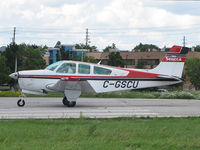 C-GSCU @ CYKZ - This 1992 Beech Bonanza of the Seneca College Flying School waiting to be cleared off runway 33 at Buttonville Airport (CYKZ) - by Ron Coates