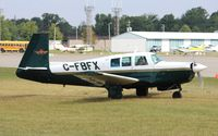 CF-BFX @ KOSH - Mooney M20F - by Mark Pasqualino