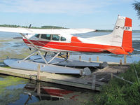 CF-FXP - This fire red Cessna looked great while resting at its home dock on Lake Scugog near Port Perry, Ontario. It must be loud when taking off among the small fishing boats. - by Chris Coates