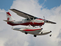 C-GGSG @ YYZ - This 1980 Cessna TU206G is landing on Rwy 23 at Toronto Int'l Airport - by Ron Coates