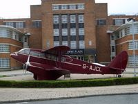 BAPC280 @ EGGP - This replica Dragon Rapide is outside the entrance to the Crowne Plaza hotel situated in the old terminal building at Liverpool Airport. - by Guitarist