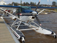 C-GYZL @ CTA5 - Strong winds made this Skywagon sound like it wanted to break free from its dock on Lac Lemoine at the Hydrobase Piche Dubuisson Seaplane near Val-d'Or, Quebec. I liked its see-through doors & the Viking emblem on its tail. - by Chris Coates