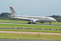 A6-EYM @ EGCC - Etihad Airbus A330-243 A6-EYM landed at Manchester Airport. - by David Burrell
