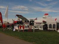 N995MF @ KOSH - Mission Aviation Fellowship display - by steveowen