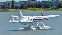 C-FTEL @ CYVR - Private Telus Kodiak taxiing out on the Fraser River. - by M.L. Jacobs