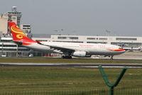 B-6089 @ EBBR - Flight HU492 is taking off on RWY 07R - by Daniel Vanderauwera