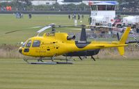 G-ORKI @ EGHR - London Helicopter AS350 parked in Goodwood. Re-registered to G-ERKN on 9-17-2013. - by FerryPNL