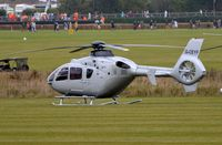 G-CEYF @ EGHR - EC135 parked for the day at Goodwood Revival 2013 - by FerryPNL