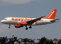 G-EZIY @ LEBL - Landing rwy 25R with additional small 'Discover Scotland' titles - by Shunn311