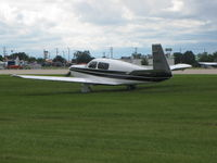C-GWFJ @ KOSH - Grass Taxi way - by steveowen