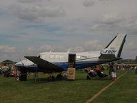 C-FBOY @ KOSH - Queen Air - by steveowen