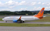 C-FYLC @ EGPH - Sunwing Boeing 737-8BK taxiing to runway 06 on a flight for Thomson holidays - by Mike stanners