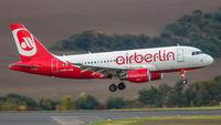 OE-LOB @ EDDR - on final after a flight from Tegel - by Friedrich Becker
