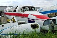 N299CA @ CYBW - Beech 99 [U-20] (Rocky Mountain Aircraft) Calgary Springbank~C 22/07/2008 Stored. - by Ray Barber