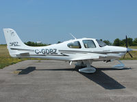 C-GDBZ @ CLA4 - This 2003 Cirrus SR22 sits in bright sunshine on the ramp at the Holland Landing Airport, (CLA4) north of Toronto - by Ron Coates