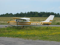 N8542J @ KMAL - This 1967 Cessna 150G sits tied down among the dandelions at the Malone-Dufort Airport in Malone NY. (KMAL) - by Ron Coates
