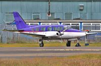 9H-FMG @ EGHH - Parked at BHL - by John Coates