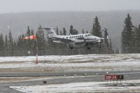 C-FLPC @ CYXY - Landing at Whitehorse, Yukon, in gusty winds and mixed rain and snow. - by Murray Lundberg