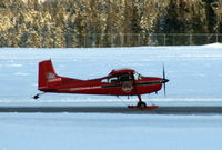 C-GLFW @ CYXY - Taking off at Whitehorse, Yukon, equipped with wheel-skis. - by Murray Lundberg