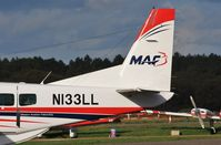 N133LL @ EGHH - Tail details with small titles Mission Aviation Fellowship - by John Coates