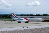 RA-85057 @ LOWG - UTair Tu-154 on the tarmac at LOWG, Graz - by Paul H