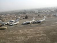 5A-DNC @ OMRK - 4 Il-76 and an An-12 at the airfield of Ras Al Khaimah (RKT) in the UAE - by Paul H