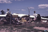 49-1912 @ BDL - CT-29A -- Aftermath of a Tornado induced 'last' flight. DBR and stored in compound. - by John Hevesi