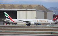 A6-ECD @ KLAX - Boeing 777-300ER - by Mark Pasqualino