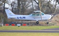 G-BJWI @ EGHH - Resident about to touchdown - by John Coates