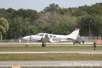 N996KR @ KSRQ - Beechcraft Baron (N996KR) arrives at Sarasota-Bradenton International Airport following a flight from Joliet Regional Airport - by Donten Photography