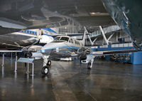66-7943 @ DWF - The much larger presidential VC-135C frames this handsome little Beech VC-6A. - by Daniel L. Berek