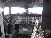 N7780B @ ENA - Cockpit of DC-6A of Everts Air Fuel  at Kenai Airport - by Jack Poelstra