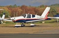 G-CBGC @ EGHH - Parked at Airtime North - by John Coates