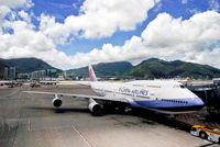 B-18273 @ VHHH - China Airlines Boeing B747-409 push back at Hong Kong International Airport. - by miro susta