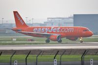 G-EZUI @ EGKK - Taxiing for misty morning departure - by John Coates