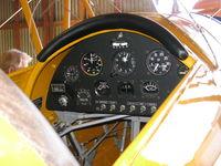 N100BU @ SZP - 1939 Dornier Werke BUCKER BU 133 JUNGMEISTER 'ANGEL', Lycoming O-360-A1D 180 Hp, instrument panel, Dornier Werke A.G. built 47 BU 133s in Switzerland, this is #19 of the 47. - by Doug Robertson
