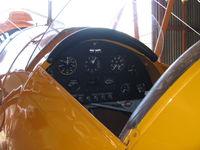 N100BU @ SZP - 1939 Dornier Werke Bucker BU 133 JUNGMEISTER 'ANGEL', Lycoming O-360-A1D 180 Hp, panel from other side, Dornier Werke A.G. built 47 BU 133s in Switzerland, this is #19 of the 47. - by Doug Robertson