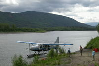 C-GMCW - Loading along the Stewart River in the Yukon. - by Murray Lundberg