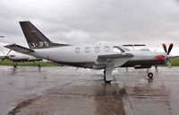 LX-JFO @ EGHH - Parked in rain after overnight stay - by John Coates