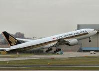 9V-SVG @ AMS - Take off from runway L18 of Schiphol Airport - by Willem Göebel