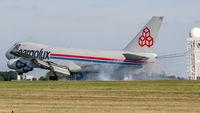 LX-FCV @ ELLX - smoky touchdown at Luxembourg - by Friedrich Becker