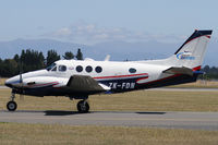 ZK-FDN @ NZCH - Flying Doctor - taxiing to hangar to meet ambulance - by Bill Mallinson
