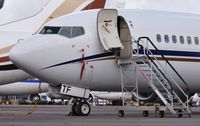 SX-ATF @ EGHH - Spurs taxi on a busy ramp at European - by John Coates
