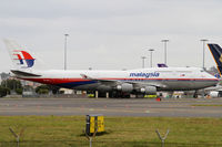 9M-MPL @ YSSY - taxiing from 34L - by Bill Mallinson