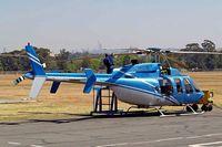 ZS-RJE @ FAGM - Bell 407 [53175] Johannesburg-Rand~ZS 21/09/2006