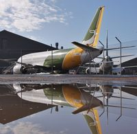 C-GOKF @ EGHH - Sat reflecting - by John Coates