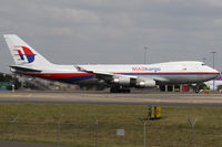 9M-MPS @ YSSY - taxiing from 34L - by Bill Mallinson